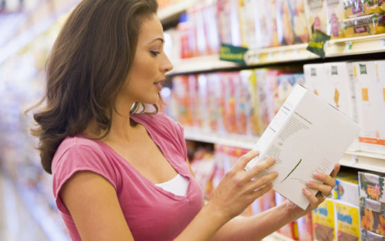 shopper looking at food nutrition labeling