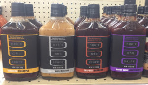 the product packaging for hak's brand bbq sauces