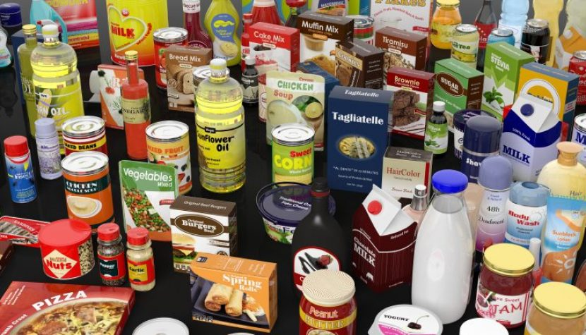 Various grocery products closeup, on black background with reflections
